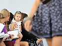 Harper Seven sits  on Victoria Beckham's  lap as she watches her mothers Victoria show  at  New York Fashion Week, Tuesday September 11, 2012..Permission By Victoria Beckham has been given to use these pictures. (c) Stephen Lock / i-Images/DyD Fotografos