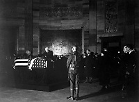 President Harding placing wreath of flowers on casket of Unknown Soldier in rotunda of the Capitol.  November 9, 1921. (Army)<br /> NARA FILE #:  111-SC-74402<br /> WAR & CONFLICT BOOK #:  708