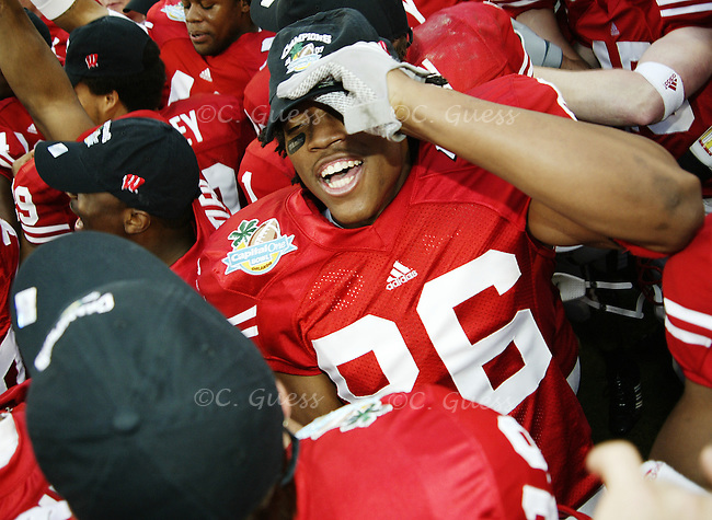 Wide receiver T.J. Theus dons his new championship hat amid a crowd of teammates just minutes after the game ended.<br />