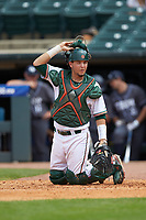 Joe Gomez (40) of the Miami Hurricanes looks to the dugout for a call the Georgia Tech Yellow Jackets during game one of the 2017 ACC Baseball Championship at Louisville Slugger Field on May 23, 2017 in Louisville, Kentucky. The Hurricanes walked-off the Yellow Jackets 6-5 in 13 innings. (Brian Westerholt/Four Seam Images)