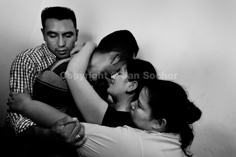 A Colombian couple, hugged by missionaries, cry during the religious healing ritual performed at a house church in Bogota, Colombia, 28 January 2013. Hundreds of Christian belivers, joined in nameless groups, gather every week in unmarked home churches dispersed in the city outskirts, to carry out prayers of liberation and exorcism. Community members and their religious activities are usually conducted by a charismatic pastor or preacher. Using either non-contactive methods (reading religous formulas from bible, displaying Christian symbols and icons) or rough body-pressure-points techniques and forced burping, a leading pastor commands the supposed evil spirit, which is generally believed to come from witchcraft, to depart a person's mind and body. The demon's expulsion often consists of multiple rites and may last for several months.