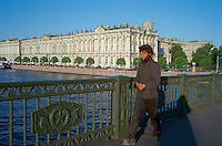 Saint Petersburg, Russia, June 2002..Fyodor Dostoyevsky, chronicler of Russia's under class, would still recognise much in his native city. A homeless man crosses Palace Bridge in front of the Hermitage, former home of the Tsars, and one of the world's great museums..