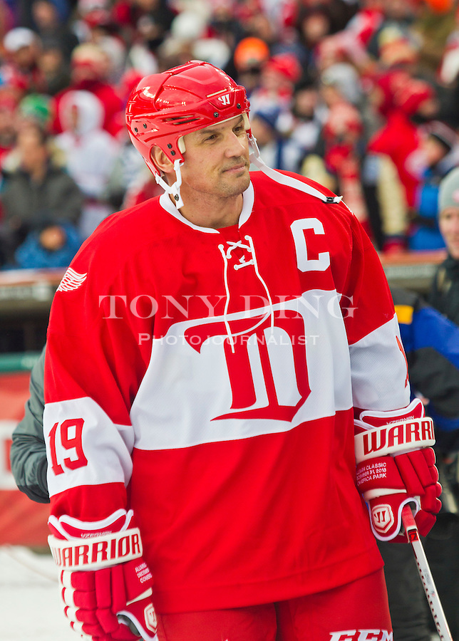 31 December 2013: Former Detroit Red Wings forward and former captain Steve Yzerman (19) walks toward the rink during player introductions before the Toronto Maple Leafs v Detroit Red Wings Alumni Showdown hockey game, at Comerica Park, in Detroit, MI.