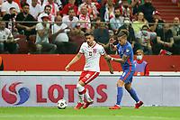 8th September 2021; PGE National Stadium, Warsaw, Poland: FIFA World Cup 2022 Football qualification, Poland versus England;  JAKUB MODER holds off KALVIN PHILLIPS