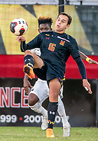 COLLEGE PARK, MD - NOVEMBER 03: Umar Farouk Osman #10 of Michigan defends against Jacob Chakroun #16 of Maryland during a game between Michigan and Maryland at Ludwig Field on November 03, 2019 in College Park, Maryland.
