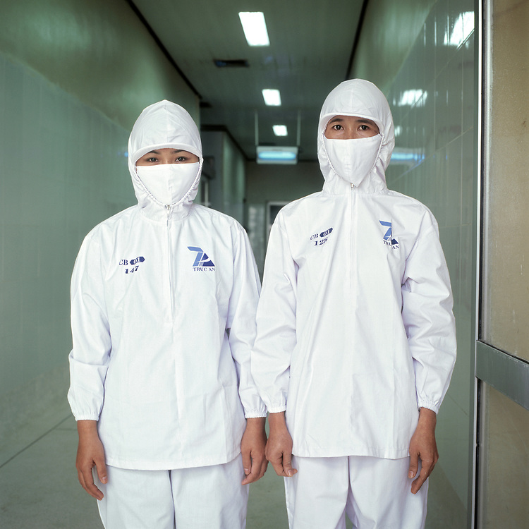 © 2021 John Angerson.<br /> Dressed in sterile uniforms workers Bui Truong Tci and Phani Thi Thanh Canh at the Truc Anh Co. Ltd warm water prawn factory.