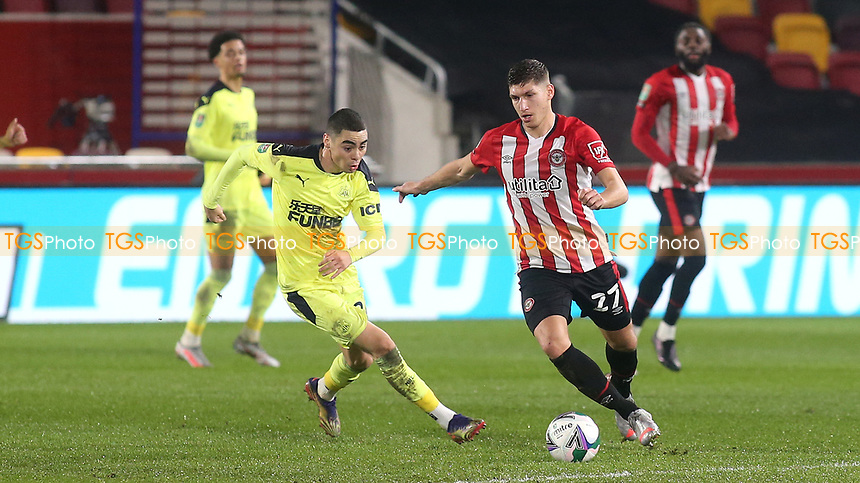 Vitaly Janelt of Brentford in action as Newcastle's Miguel Almiron looks on during Brentford vs Newcastle United, Carabao Cup Football at the Brentford Community Stadium on 22nd December 2020