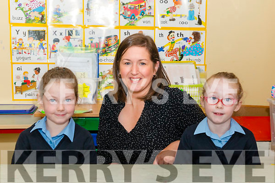 First day of school for twins junior infants Doireann and Aoife O'Sullivan at the Hollymount NS Rathmore last Monday pictured with class teacher and principal Caroline Ruiseal.