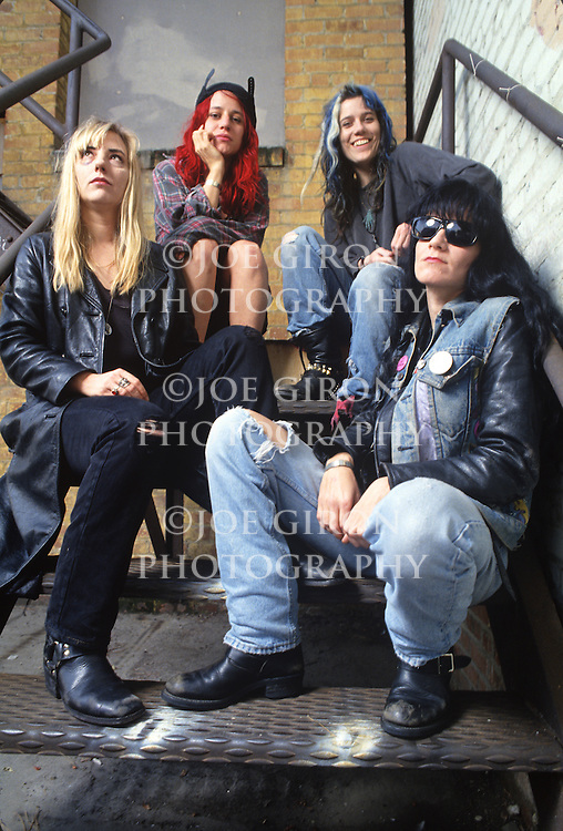 Various portraits & live photographs of the rock band, L7.