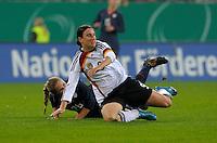 Rachel Buehler and Birgit Prinz. US Women's National Team defeated Germany 1-0 at Impuls Arena in Augsburg, Germany on October 29, 2009.