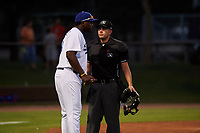AZL Dodgers Mota manager Jair Fernandez (18) argues a call with home plate umpire Jesse Segura during an Arizona League game against the AZL Rangers at Camelback Ranch on June 18, 2019 in Glendale, Arizona. AZL Dodgers Mota defeated AZL Rangers 13-4. (Zachary Lucy/Four Seam Images)