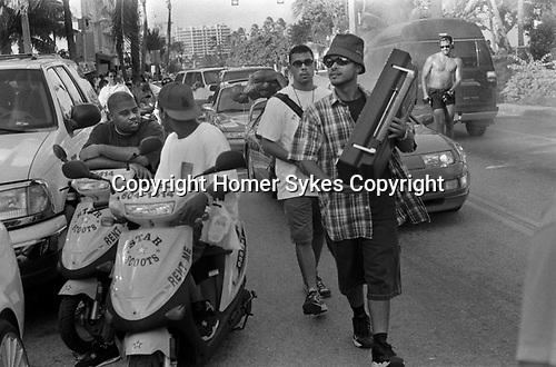 African American young men hanging out South Beach, Ocean Drive,  Miami Florida USA  1999. Ghetto blaster portable radio.
