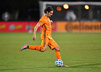 LAKE BUENA VISTA, FL - JULY 18: Zarek Valentin #4 of the Houston Dynamo passes the ball during a game between Houston Dynamo and Portland Timbers at ESPN Wide World of Sports on July 18, 2020 in Lake Buena Vista, Florida.