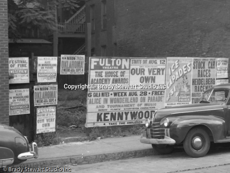 Pittsburgh PA:  Event Posters covering a lot on Forbes Avenue near Magee Street and Duquesne University.<br /> <br /> Fulton and Nixon Theatre advertisements, Races at Heidelberg Speedway, Kennywood, and Westview Park announcements.