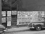 Pittsburgh PA:  Event Posters covering a lot on Forbes Avenue near Magee Street and Duquesne University.<br />