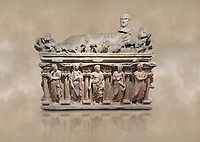 "Roman relief sculpted sarcophagus with kline couch lid with a reclining male figuer depicted, ""Columned Sarcophagi of Asia Minor"" style typical of Sidamara, 3rd Century AD, Konya Archaeological Museum, Turkey. Against a warm art background."