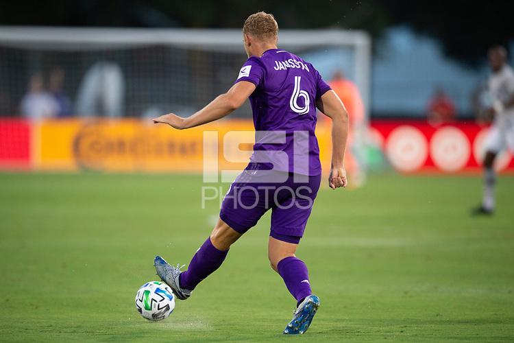 LAKE BUENA VISTA, FL - JULY 25: Robin Jansson #6 of Orlando City SC kicks the ball during a game between Montreal Impact and Orlando City SC at ESPN Wide World of Sports on July 25, 2020 in Lake Buena Vista, Florida.