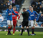 Bilel Mohsni apologises after kicking the ball away but knows he is about to be sent off