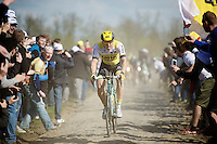 A very strong Sep Vanmarcke (BEL/LottoNL-Jumbo) jumps away from the lead group on the infamously rough cobbles of sector 4: Carrefour de l'Arbre (2.1km), only 17 km from the finish<br /> <br /> 114th Paris-Roubaix 2016