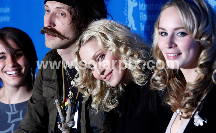 """**ALL ROUND PICTURES FROM SOLARPIX.COM**.**SYNDICATION RIGHTS FOR UK AND SPAIN ONLY**.Madonna during the photocall """"Filth And Wisdom"""" at the 58th Berlin Film Festival (Berlinale) in Berlin, Germany. 13th February 2008..This pic: Vicky McClure, Eugene Hutz, Madonna and Holly Weston..JOB REF: 5782  CPR        DATE: 13_02_2008.**MUST CREDIT SOLARPIX.COM OR DOUBLE FEE WILL BE CHARGED* *UNDER NO CIRCUMSTANCES IS THIS IMAGE TO BE REPRODUCED FOR ANY ONLINE EDITION WITHOUT PRIOR PERMISSION*"""