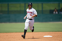 Seby Zavala (21) of the Kannapolis Intimidators rounds the bases after hitting a home run against the West Virginia Power at Kannapolis Intimidators Stadium on June 18, 2017 in Kannapolis, North Carolina.  The Intimidators defeated the Power 5-3 to win the South Atlantic League Northern Division first half title.  It is the first trip to the playoffs for the Intimidators since 2009.  (Brian Westerholt/Four Seam Images)