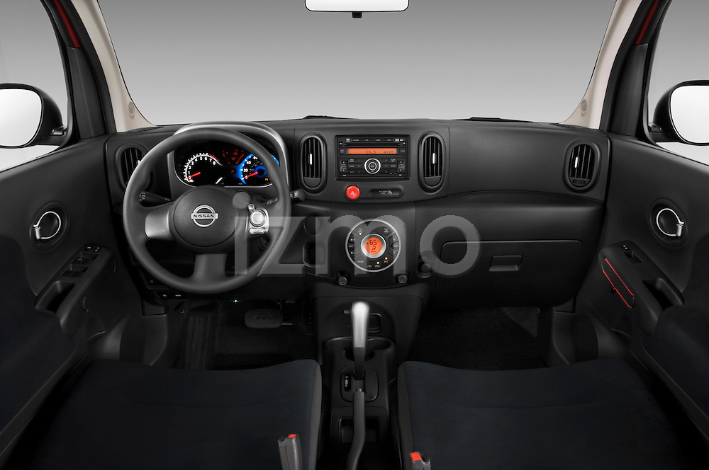 Straight dashboard view of a 2009 Nissan Cube SL.