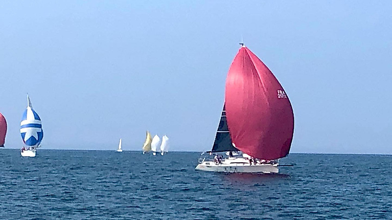 Tribal leading WIORA on a benign Atlantic at Tralee Bay. She's a classic vintage Farr which continues to be competitive.