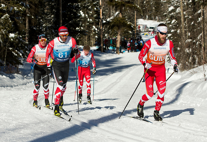 Prince George, B.-C., 24 February/2019 - Jesse Bachinsky and Guide Simon Lamarche Can (53) and Brian McKeever and Guide Graham Nishikawa (61) .. Final results - Brian McKeever CAN (61) and guide Graham Nishikawa (gold), Sebastian Modin SWE (55) and guide Emil Joensson (silver), Erik Bye NOR (57) and guide Arvid Nelson (bronze) in the Classic Cross Country Long Visually Impaired Men's event at the 2019 World Para Nordic skiing Championships in Prince George, B.C. Photo Bob Frid/Canadian Paralympic Committee.