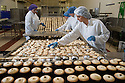 """06/12/16<br /> <br /> *** Caption correction Paragraph 7 should read 34 million not 400 million*** (In total M&S will sell around 34 million mince pies...)<br /> <br /> Paige Farrington, 21.<br /> <br /> Things are REALLY hotting up at Britain's busiest M&S mince pie factory – which will bake a staggering 23 million of the festive favourites in the run-up to Christmas.<br /> <br /> Staff at Park Cakes Bakery in Bolton oversee the production of 375 all-butter pies every minute – that's a phenomenal 22,500 every hour.<br /> <br /> <br /> FULL STORY: https://fstoppressblog.wordpress.com/mince-pies/<br /> <br /> This means a mouth-watering 360,000 mince pies have rolled off the production line every day since the Christmas rush began on September 22.<br /> <br /> And unsurprisingly, quality control is all important with every mince pie having to be the perfect weight, finish and colour so that they pass the retail giant's strict guidelines.<br /> <br /> The actual recipe for the M&S pies is a closely guarded secret with just ten people aware of the full recipe.<br /> <br /> Cooked at 200 degrees Celsius for nine and half minutes, each pie takes 45 minutes to make from start to finish.<br /> <br /> In total M&S will sell around 400 million mince pies – that's an average of six for every man, woman and child in Britain - until the last one rolls off the production line on December 16.<br /> <br /> Bakery employee Megan Davies, 25, said: """"Everyone here takes great pride in producing pies for Marks and Spencer.<br /> <br /> """"It's a really busy period for us, but we have a great team and everyone is focused on the job in hand.<br /> <br /> """"The best thing about it is the smell of the pies when they come out of the oven – it's divine!<br /> <br /> """"I hadn't really thought before about the actual number of pies we make here, it's incredible to think that many roll off the production line and end up being eaten by people all over the country.""""<br /> <br /> All Rights Reserved F"""