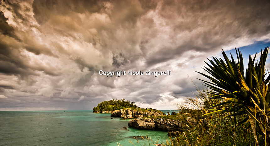 Cloudy and stormy sky overlooking a coastal outcrop in Bermuda