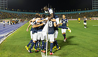 Kingston, Jamaica - Friday, September 7, 2012: The USMNT lost to Jamaica 2-1 during World Cup Qualifying at National Stadium. Clint Dempsey is congratulated after scoring a goal.