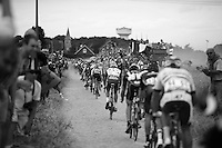 peloton over the cobbled sector of Artres (1200m)<br /> <br /> stage 4: Seraing (BEL) - Cambrai (FR) <br /> 2015 Tour de France
