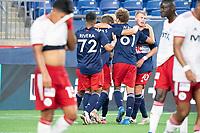 FOXBOROUGH, MA - JUNE 26: New England Revolution II celebrate their first goal against North Texas SC during a game between North Texas SC and New England Revolution II at Gillette Stadium on June 26, 2021 in Foxborough, Massachusetts.