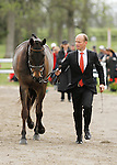 LEXINGTON, KY - APRIL 27: #34 Fischerrocana FST, and rider Michael Jung from Germany who won the 2015 Rolex Three Day Event,  jog before the vets and grand jury during the first horse inspection for the Rolex Three Day Event on Wednesday April 27, 2016 in Lexington, Kentucky. (Photo by Candice Chavez/Eclipse Sportswire/Getty Images)