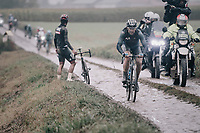 passing by a stranded Fernando Gaviria (COL/UAE-Emirates)<br /> <br /> 118th Paris-Roubaix 2021 (1.UWT)<br /> One day race from Compiègne to Roubaix (FRA) (257.7km)<br /> <br /> ©kramon