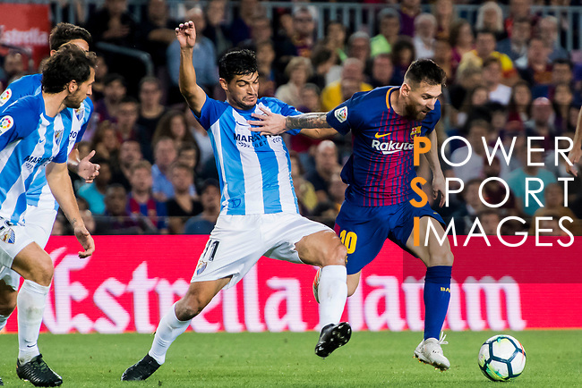 Lionel Andres Messi (r) of FC Barcelona fights for the ball with Chory Castro of Malaga CF during the La Liga 2017-18 match between FC Barcelona and Malaga CF at Camp Nou on 21 October 2017 in Barcelona, Spain. Photo by Vicens Gimenez / Power Sport Images