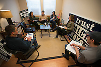 Anchorage mayoral candidate Andrew Halcro meets with his campaign staff at his campaign office in Diamond. Photo by James R. Evans / Anchorage Press