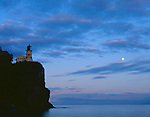 Split Rock Lighthouse State Park, MN  <br /> Split Rock Lighthouse stands above Lake Superior facing rising moon and sunset colored clouds