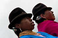 """Women, wearing men's hats, watch a procession during the Inti Raymi celebration in Pichincha province, Ecuador, 26 June 2010. Inti Raymi, """"Festival of the Sun"""" in Quechua language, is an ancient spiritual ceremony held in the Indian regions of the Andes, mainly in Ecuador and Peru. The lively celebration, set by the winter solstice, goes on for various days. The highland Indians, wearing beautiful costumes, dance, drink and sing with no rest. Colorful processions in honor of the God Inti (Sun) pass through the mountain villages giving thanks for the harvest and expressing their deep relation to the Mother Earth (Pachamama)."""