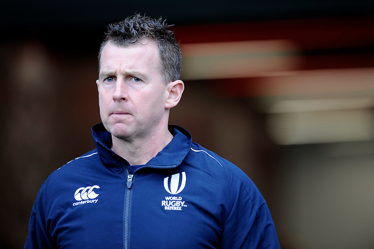 Referee Nigel Owens of Wales comes onto the Twickenham pitch for the first time since he was homophobically and racially abused in England vs New Zealand match in November 2014