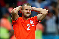 Ron Vlaar of Netherlands shows a look of dejection after missing his penalty in the shootout