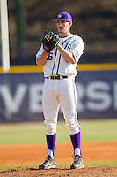 High Point Panthers relief pitcher Jon Carlson (26) looks to his catcher for the sign against the Bowling Green Falcons at Willard Stadium on March 9, 2014 in High Point, North Carolina.  The Falcons defeated the Panthers 7-4.  (Brian Westerholt/Four Seam Images)