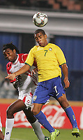 Brazil's Alex Teixeira (7) headers the ball over Costa Rica's Roy Smith (3) during the FIFA Under 20 World Cup Semi-final match at the Cairo International Stadium in Cairo, Egypt, on October 13, 2009. Brazil won the match  1-0.