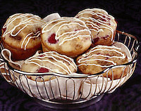 Raspberry Muffins with striped white Icing in Metal Basket