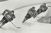 1981 FILE PHOTO - ARCHIVES -<br /> <br /> Sweeping through: This Team Canada line; from left; of Montreal Canadiens Steve Shutt; Wayne Gretzky of Edmonton Oilers and Canadiens Guy Lafleur has played together less than a week but appear in perfect harmony during practice at Montreal Forum. Gretzky has expressed great excitement at playing with Lafleur. Shutt scored twice; Lafleur once; in the team's third scrimmage yesterday in preparation for Canada Cup series next month. There are 35 players at camp.<br /> <br /> 1981<br /> <br /> PHOTO :  Frank Lennon  - Toronto Star Archives - AQP