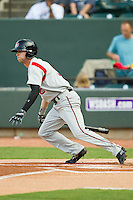 Tyler Naquin (6) of the Carolina Mudcats follows through on his swing against the Winston-Salem Dash at BB&T Ballpark on July 25, 2013 in Winston-Salem, North Carolina.  The Mudcats defeated the Dash 5-4.  (Brian Westerholt/Four Seam Images)