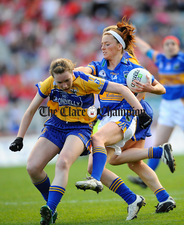 Clare's Fiona Lafferty challenges Tipperary's Gillian O Brien during the Intermediate Ladies Football final at Croke Park. Photograph by John Kelly.