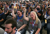 Attendees cheer, Friday, June 4, 2021 during the annual Walmart Associate Celebration at the Arkansas Music Pavilion in Rogers. Walmart held their associates meeting mostly virtually with a small celebration in person at the AMP. Check out nwaonline.com/210605Daily/ for today's photo gallery. <br /> (NWA Democrat-Gazette/Charlie Kaijo)