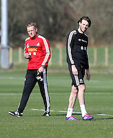 Pictured L-R: Manager Garry Monk and Michu. Saturday 08 March 2014<br /> Re: Swansea City FC training at the Fairwood Training ground in the outskirts of Swansea, south Wales.