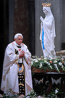 A statue of Our Lady of Lourdes (L) is displayed as Pope Benedict XVI leads a mass for the Feast of Our Lady of Lourdes and the XVIII World Day of the Sick on February 11, 2010 at St Peter's basilica at The Vatican